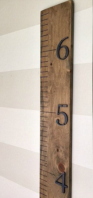 A modern, rustic growth chart ruler is the perfect accessory to any childs room. Track your childs height as they grow by using a sharpie or paint pen. No more painting over wall marks or leaving marks behind when you move! Growth chart stands 6 ft tall, though measurement starts at 8 inches to accommodate being hung above a standard size baseboard. Makes a great baby shower gift! Item is shown in Special Walnut, but can be made a shade darker in Dark Walnut also. Numbers are 3 dimensional...