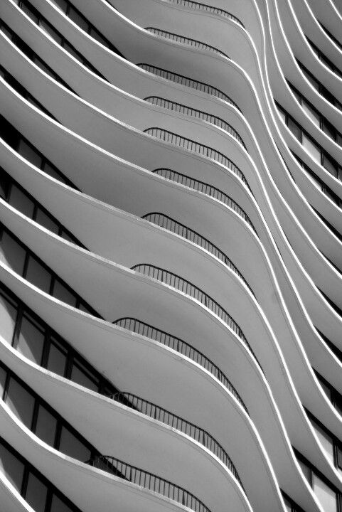 This picture is an example of pattern the building has a regular repetition of shapes that keeps on going and going.: