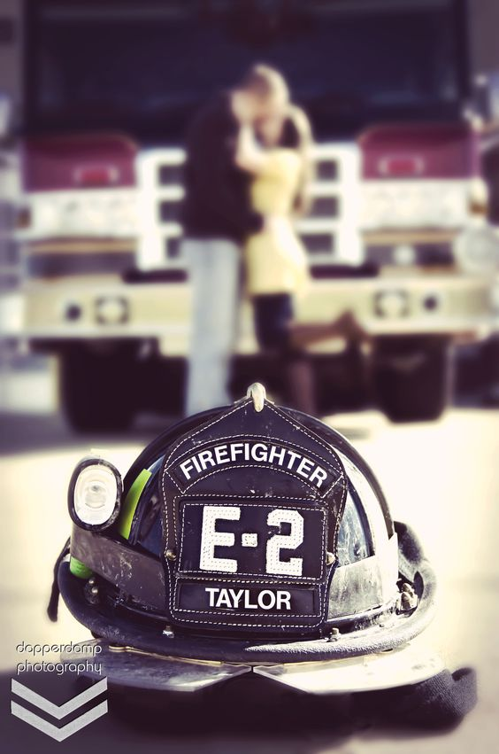 Firefighter engagement photo. Would be cuter with both my helmet and my man's...whoever that may be by then lol