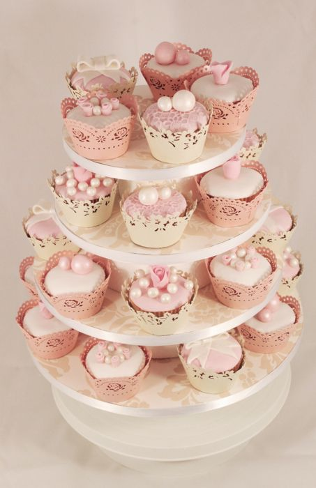 beautifully decorated pink wedding cupcakes, even the wrapping is adorable
