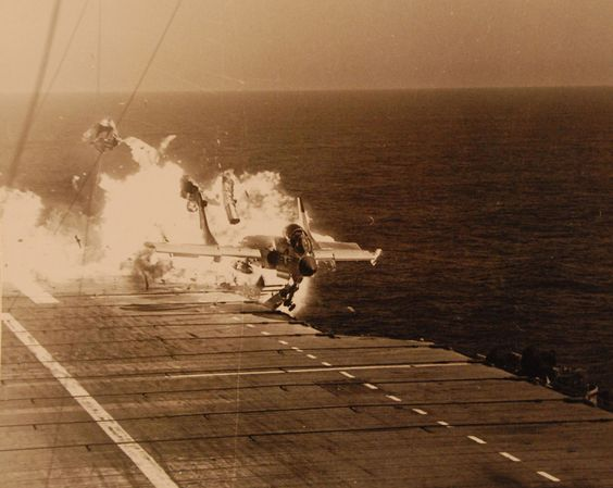 "Ramp strike of Vought F7U-3 Cutlass BuNo. 129595 ""412"" of VF-124 ""Stingrays"" on the USS Hancock on 14 July 1955. LCDR Jay T. Alkire (XO of VF-124) was killed in the crash, and several deck crew were killed / injured."