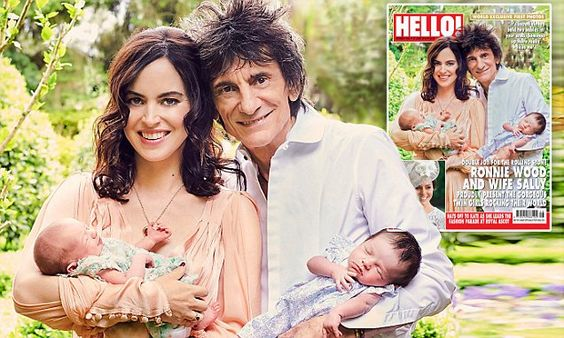 Ronnie Wood and wife Sally present their twin daughters to the world