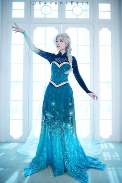 Elsa in the middle of her dress transformation. Omg. The single best Elsa cosplay ever.