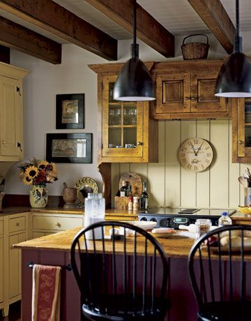 Choice #2 on my kitchen...the historically inspired kitchen that makes you think of the old kitchens at Shaker villages, etc.  I love the mustard colored cabinets against the dark shares and the black lighting.  Not quite as beautiful as white--but beautiful!