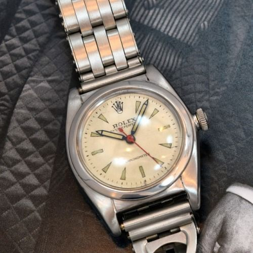 A fantastic Rolex ca. 1944 Bubbleback Ref. 2940 stainless steel watch. The white dial is intriguingly patinated, and features elongated, luminous arrow markers. This piece also has a period-correct, stainless steel stretchy rivet bracelet. Very cool! (Store Inventory # 9773, listed at $4350).  #rolex #vintagerolex #bubbleback #vintage #watchcollector #watches #watch #timepieces #classic watches #stawc