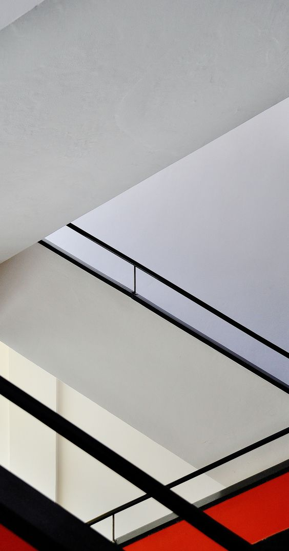 A staircase in the Bauhaus school of design, Staatliches Bauhaus, in Dessau, Germany. photo  by clockwithnohands