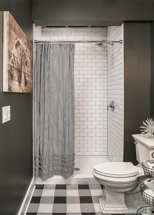 White Subway Tiles Frame A Wall In A Walk In Shower With A Black