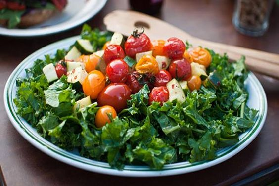 """Kale and Fresh Tomato Salad  www.runnerchallenge.com   Prep Time: 10 Minutes  Ready In: 10 Minutes  Servings: 4  """"Hearty kale makes a delicious green salad with sunflower seeds and dried cranberries.""""  https://www.facebook.com/photo.php?fbid=10202789695094467&set=oa.226682400841437&type=3&theater"""