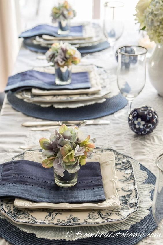 | Hydrangea-inspired Blue and White Tablescape | If you're looking for Easter dinner or spring table ideas, this blue and white table setting has a hydrangea centerpiece that is perfect for the occasion. The blue and white place setting is really pretty, too.