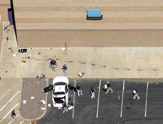 Movie Massacre Aftermath:                Police examine the car of James Eagan Holmes behind the theater where he fired on moviegoers in Aurora, Colo., July 20, 2012. The shooting left 12 people dead and 58 wounded. Police say Holmes also booby-trapped his Aurora apartment with explosives.