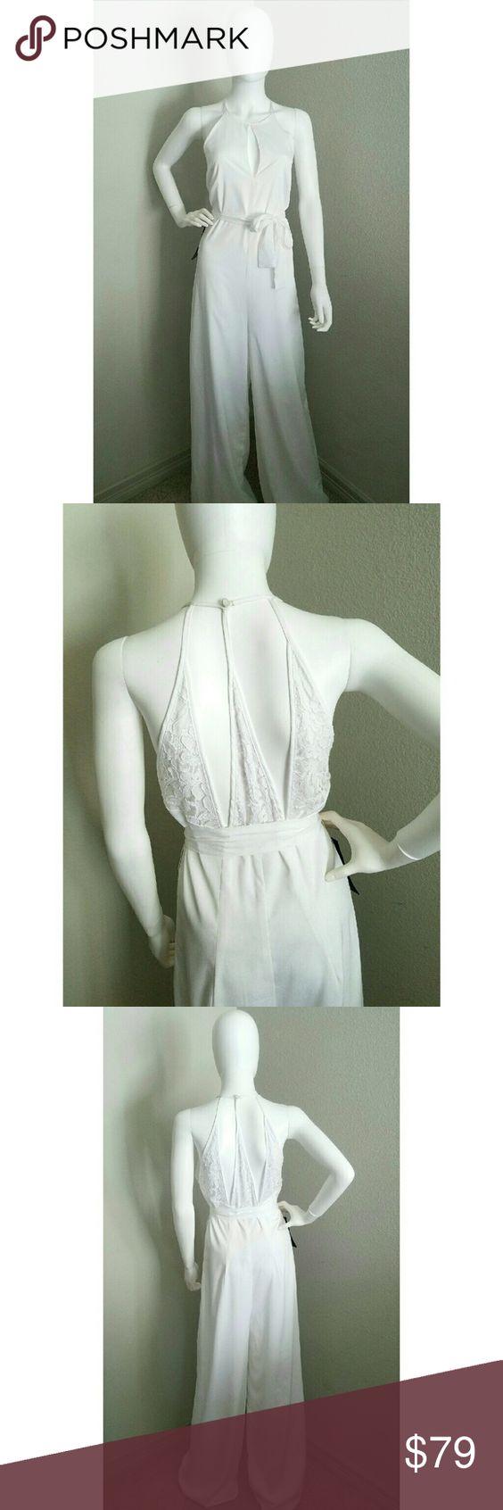 BEBE Three Panel Back Lace Jumpsuit NWT.  Super elegant! bebe Dresses