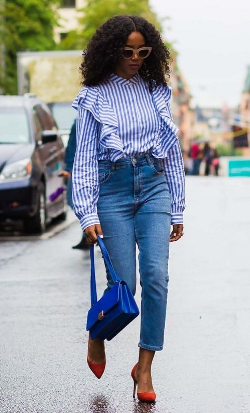 A blue and white striped ruffled shirt and high-waisted denim. See more street style from Stockholm Fashion Week. Photographed by Photographed by Acielle / Style du Monde.: