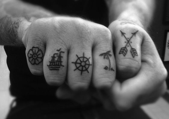 Finger tattoo - love the arrows and flower