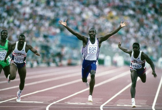 Linford Christie victorious after winning gold during Men's 100M Final at the 1992 Olympic Games in Barcelona