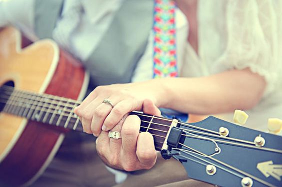 Guitar engagement /wedding photo : ) This is one of the reasons why I need a boy who can play the guitar.