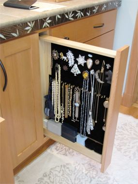 bathroom jewelry storage.. this would be better as a higher cabinet.