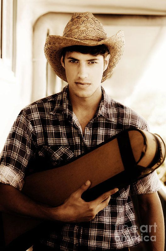 Serious Young Man In Chequered Shirt And Straw Hat Heading West While Carrying A Guitar Case Under Arm In A Image Title Just Plaid Country And Western Musician by Ryan Jorgensen