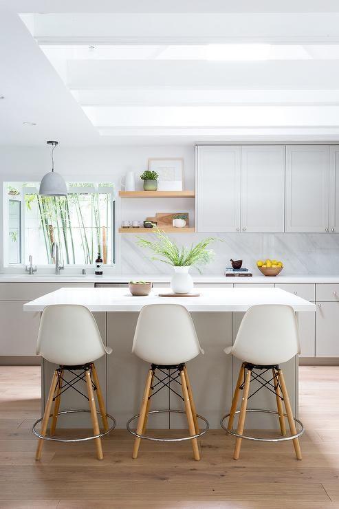 Light Gray Island With Wood Dowel Legged Stools Modern Kitchen