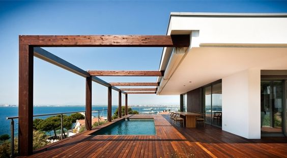 Home overlooking the Bay of Roses on the Costa Brava, Spain. By Magma architects. The roof over the pool area is rolled up in this picture, but can roll out over the pool for shade.
