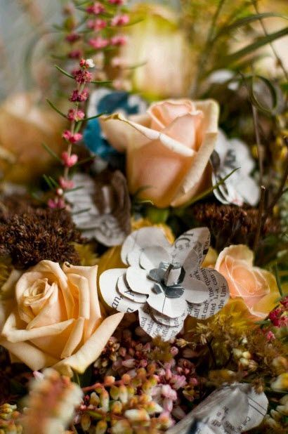 Detail shot of rustic winter wedding bridal bouquet made with paper flowers