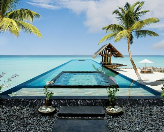 infinity pool with hot tub and beach - wide angle