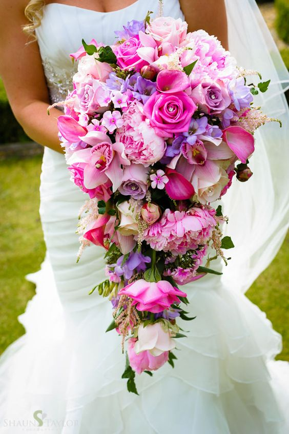 English countryside wedding featured on The English Wedding Blog. Photo by Shaun Taylor. Brides bouquet with pink and lilac roses