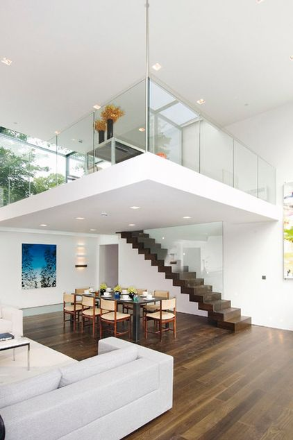 a cantilevered staircase leads up to the mezzanine office area which appears to be hanging from. Black Bedroom Furniture Sets. Home Design Ideas
