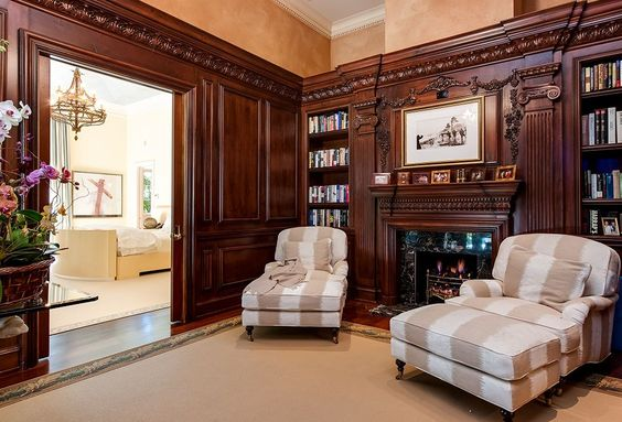 Traditional Home Office with specialty door, stone fireplace, Crown molding…