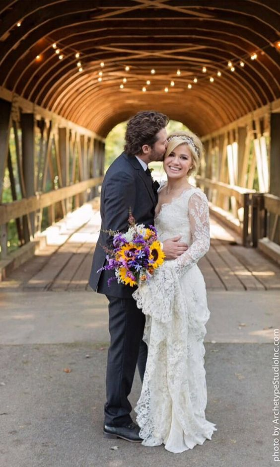Mr. and Mrs. Blackstock - So happy for her to have found the one. Wishing them both many years of happiness. She looks amazing! Love the dress! #beautiful #love #kellyclarkson