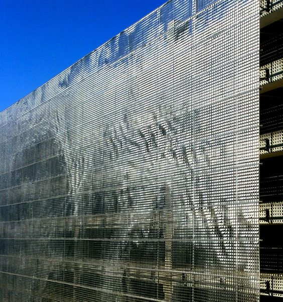 These Innovative Parking Garages Are Anything But: Shimmering Art Makes A Parking Garage Disappear