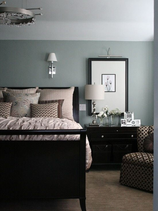 Black furniture with walls that are blue with a green tint. This is my favorite color ever. Beach Glass, 1564 by Benjamin Moore. It also looks great with Revere Pewter (HC-172).