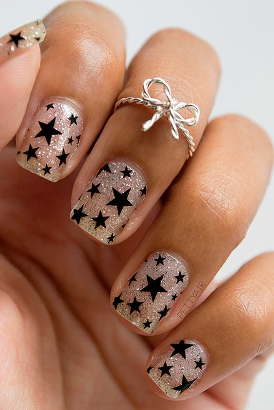 See best holiday nails with star designs. Make your nails become the star at a Christmas party!: