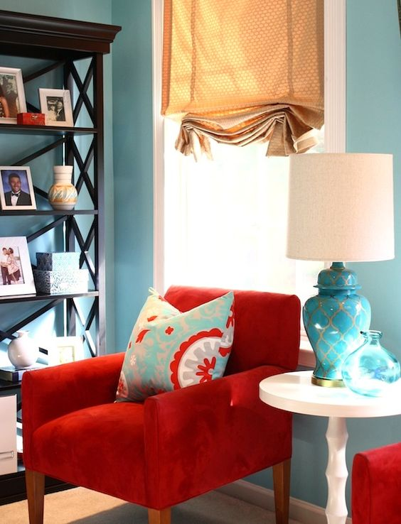 Great room makeover with red and turquoise throw pillow as accent: