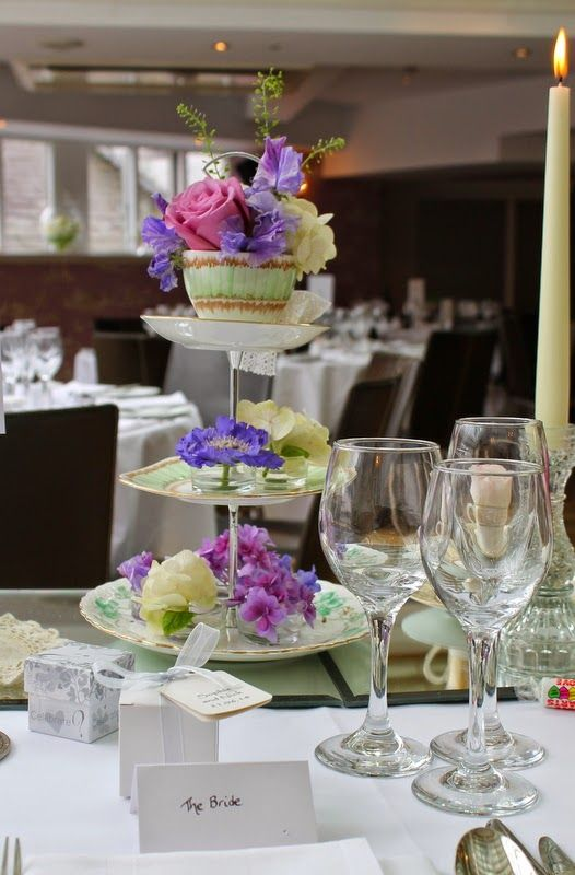 Three tier cake stand filled with Sweet Peas, Scabious, Roses, Peonies and Hydrangeas