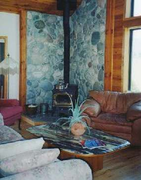 Vertical Corner Hearth Made Of River Rock For Wood Stove