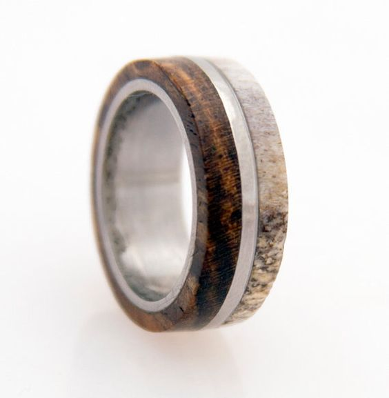 antler ring titanium ring with wood bocote deer antler band by titaniumbands on Etsy https://www.etsy.com/listing/174244463/antler-ring-titanium-ring-with-wood