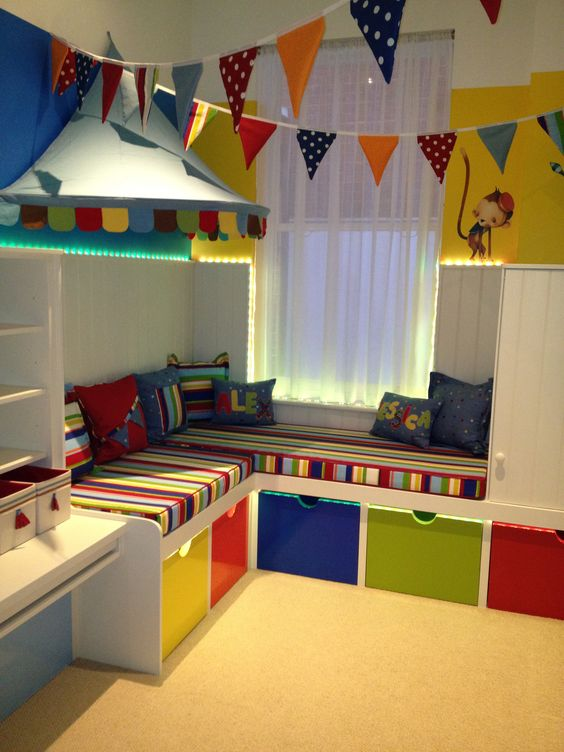 pendant banner across room, ends tied to o-rings,  secure onto cup hooks  Children's Playroom London : Austin John Interiors