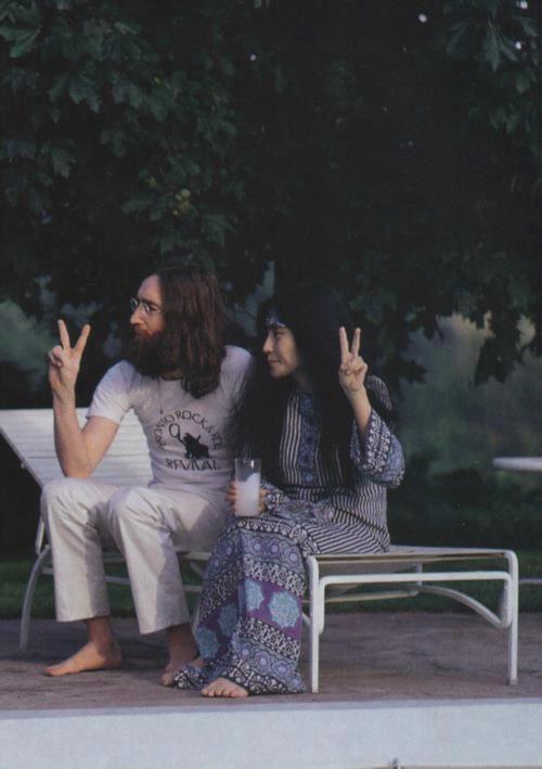 John and Yoko by the pool-peace!