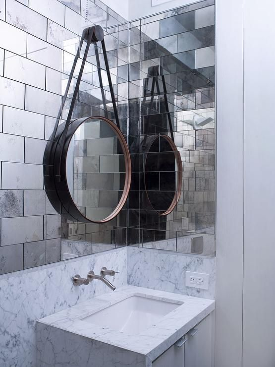 Powder room antiqued mirrored subway tiles