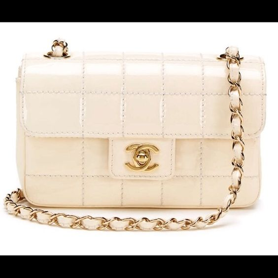 Christmas Sale: Authentic Ivory Mini Flap Bag Authentic Ivory Patent Chocolate Bar Mini Flap Bag, comes with Dust Bag and Authenticity Card. Off White Creme color, Bag is 7x4.25 inches, 2.5 wide, Strap 19.5x19.5, possible to make double stripe 8x8. Price to Sell! Bought on Gilt, have receipt. CHANEL Bags