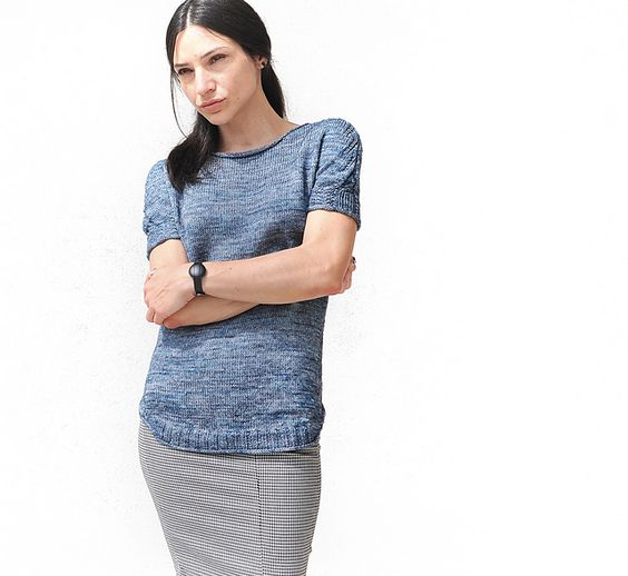 A delicate simple top with relaxed shaping for ample drape at the body. Lacy eyelets on shoulders, sleeves and the garment's sides flow into a flattering, curved hem, while playful textured details finish off the short sleeves and in combination with the centred increases produce a slightly puffed shape right above the cuff.
