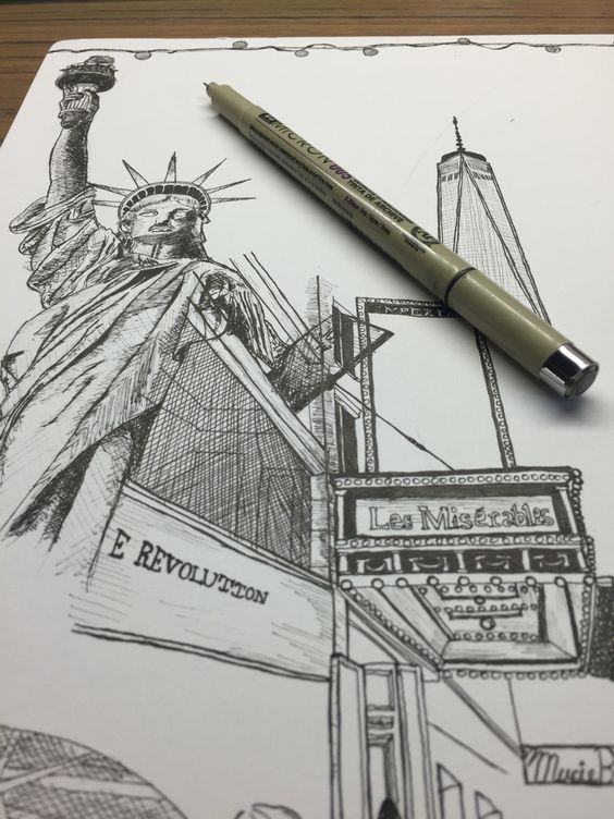 Statue of Liberty and broadway show in manhattan