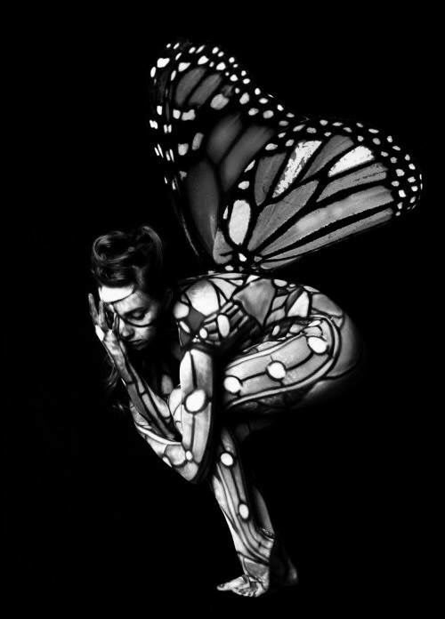 Woman with butterfly body paint & wings art
