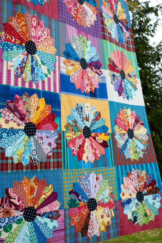 AMH Dresden Plate quilt top at Maryse Makes Things.  Stripes and plaids in the background.