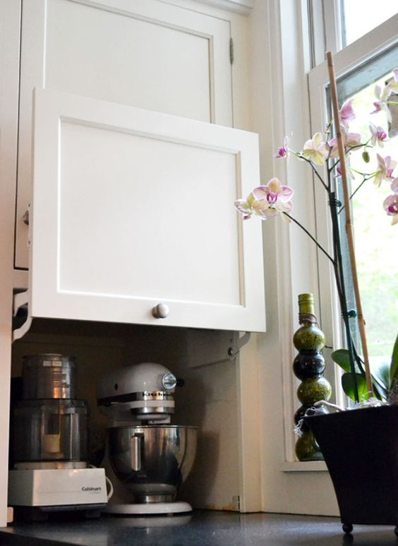kitchen aid, vitamix, food processor: keep the heavy appliances out of sight but at countertop level.