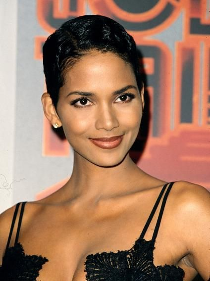Halle Berry, 1995  At the Soul Train Awards, Berry turned heads with her signature short 'do and deep red lips.