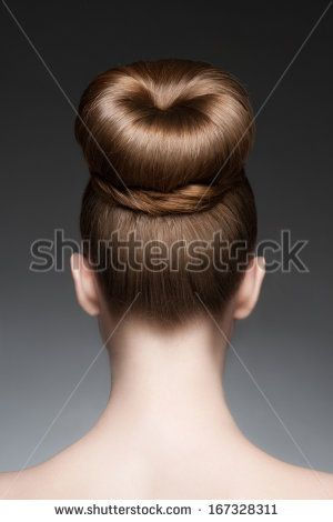Portrait of young beautiful woman with creative elegant hairstyle, hair bun. Rear view Image ID: 167328311 Copyright: Malyugin