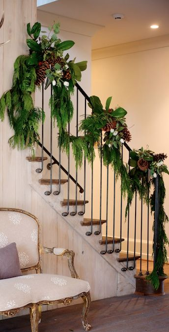 Very pretty fresh garland. Not sure I'd add the tulips due to their limited longevity but those magnolia and eucalyptus leaves are ideal! Also love the stair railing!: