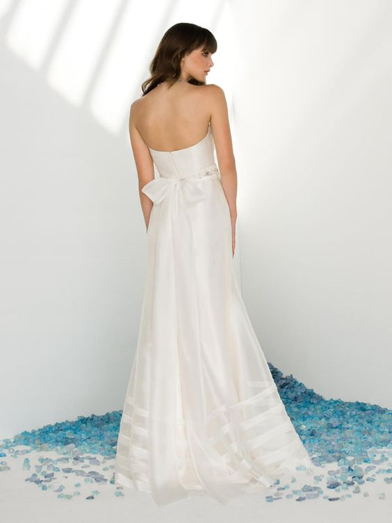 gorgeous sash trickles down the back of this A-line wedding dress.