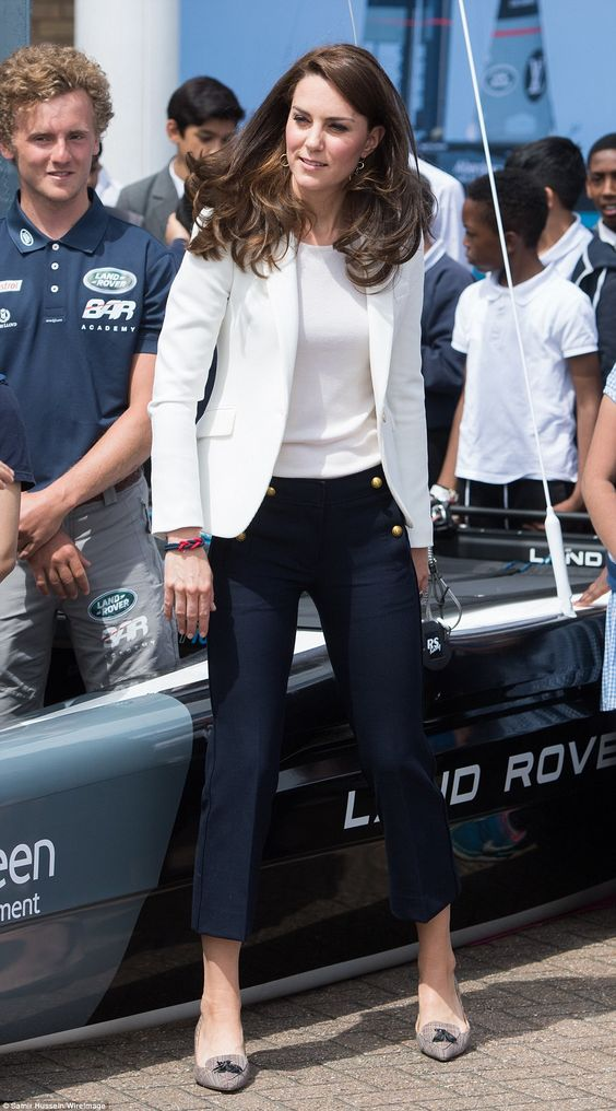 Kate displayed her long legs in chic navy trousers, which she teamed with trendy heeled sh... Catherine's nautical looking outfit -- white top and jacket, navy cropped trousers with gold button detail, flat shoes with tassels. June 16 2017